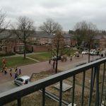 Optocht vanaf balkon